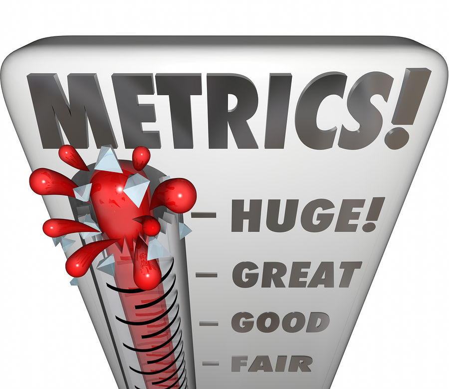 Metrics word on a thermometer or gauge measuring performance or